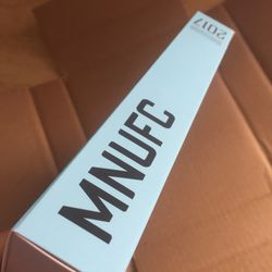"""The spine of the packaging, featuring """"MNUFC"""" and """"Inaugural Season 2017."""""""