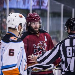 Selleck has a talk with the linesman before a faceoff