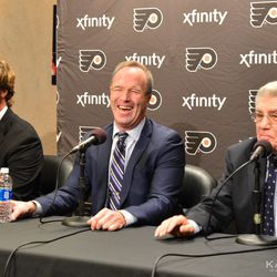 Dave Poulin and Chris Pronger laughing at Lou Angotti's old time hockey story