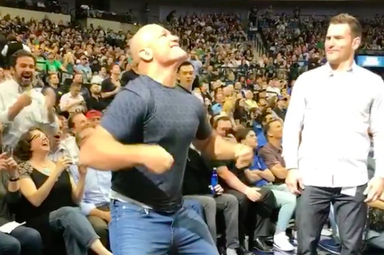 community news, Stipe Miocic, Junior dos Santos engage in flex off contest during NBA game