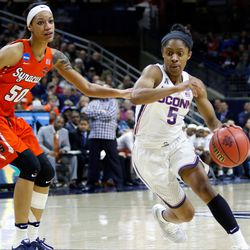UConn's Crystal Dangerfield (5) drives to the basket.