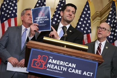 House Speaker Paul Ryan holds out the American Health Care Act.