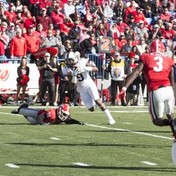 John Diarse hauls in a high pass and turns towards the end zone.