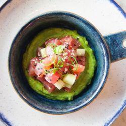 Tuna poke with avocado, grapefruit, cucumber, and yuzu.