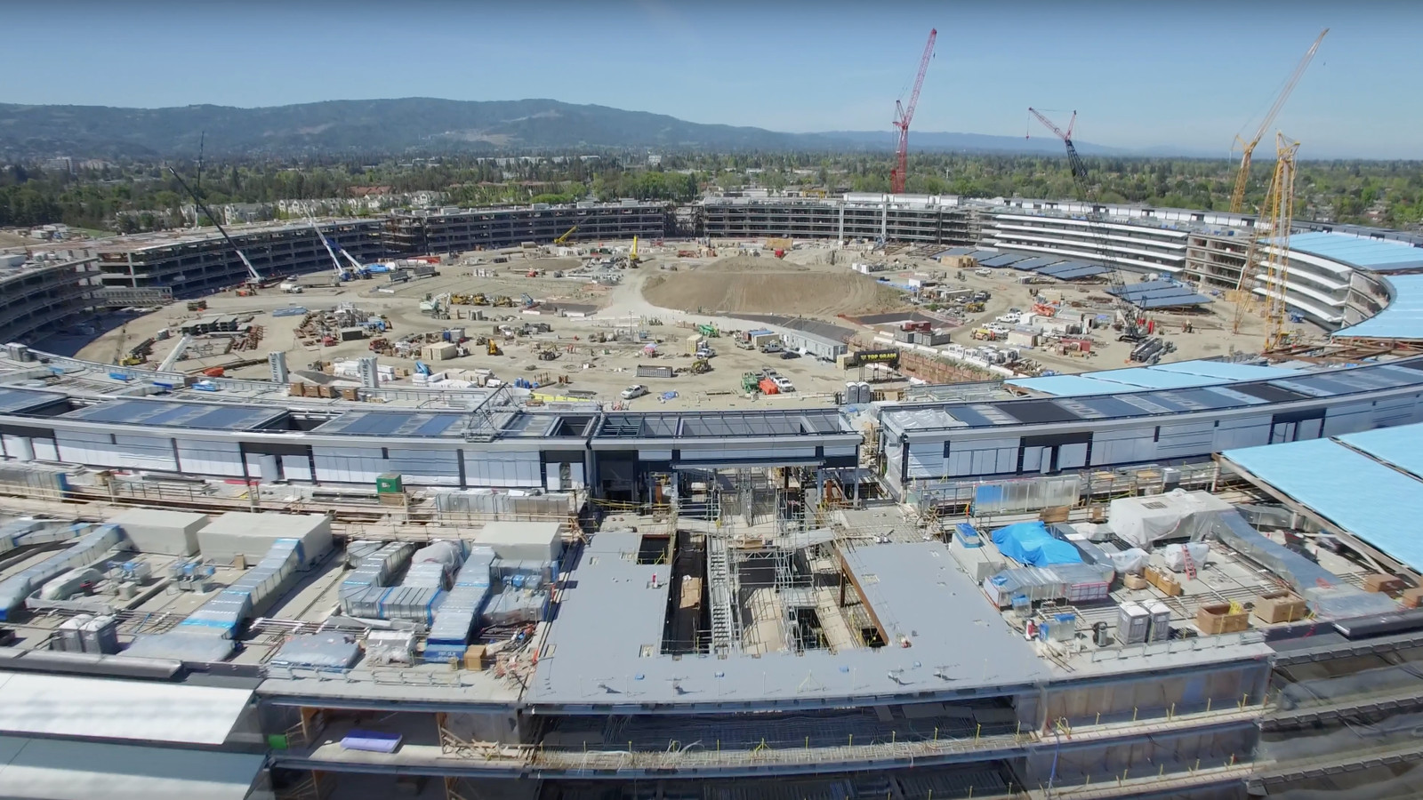 new drone video shows apples massive new spaceship campus is coming together the verge apples office