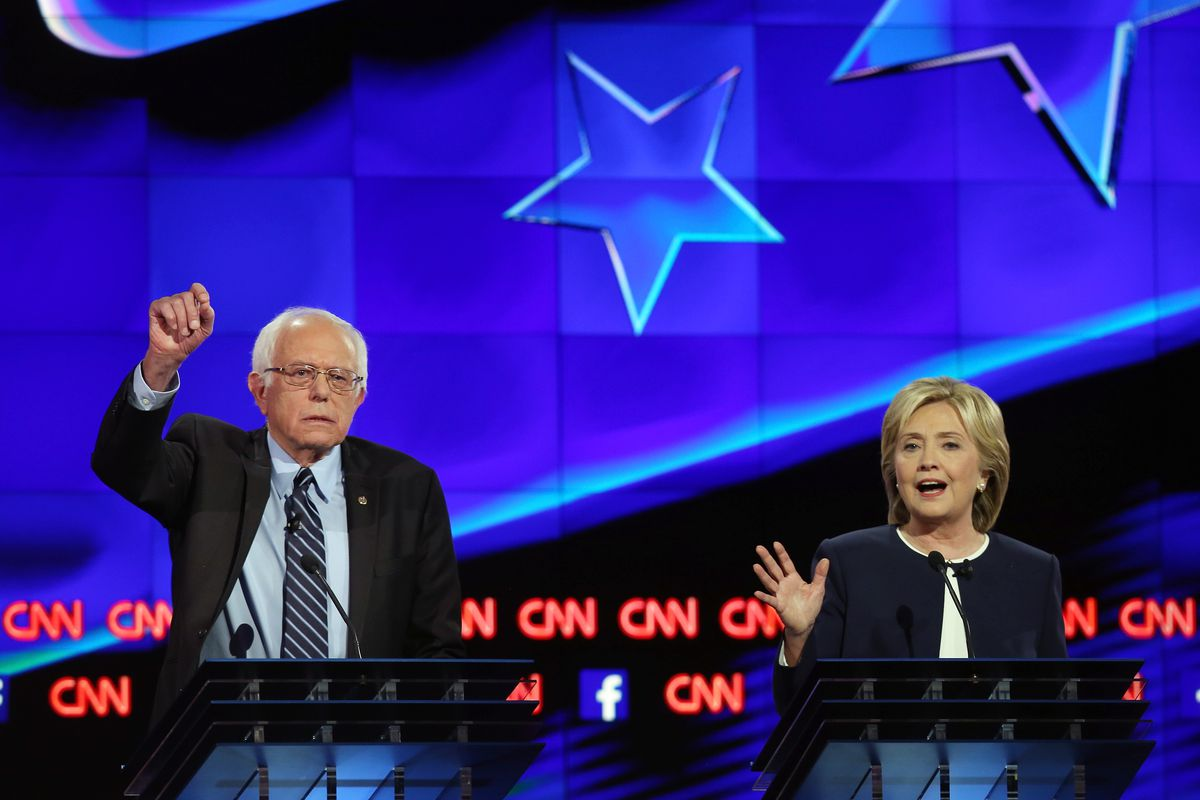hillary clinton and bernie sanders argument about college costs sanders and clinton during the debate tuesday night photo by joe raedle getty images