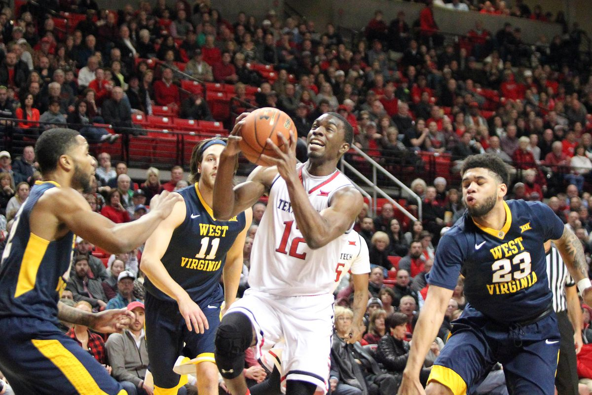 mountaineers stumble as red raiders rise in lubbock 77 76 the weird things happened on tuesday night but ultimately texas tech emerged the victor in overtime