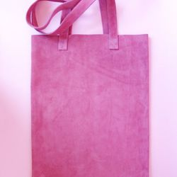 "Nana Ubach <a href=""https://tictail.com/s/nanaubach/suedetote-bag-in-lilac-color"">Suede Tote</a>, $32"