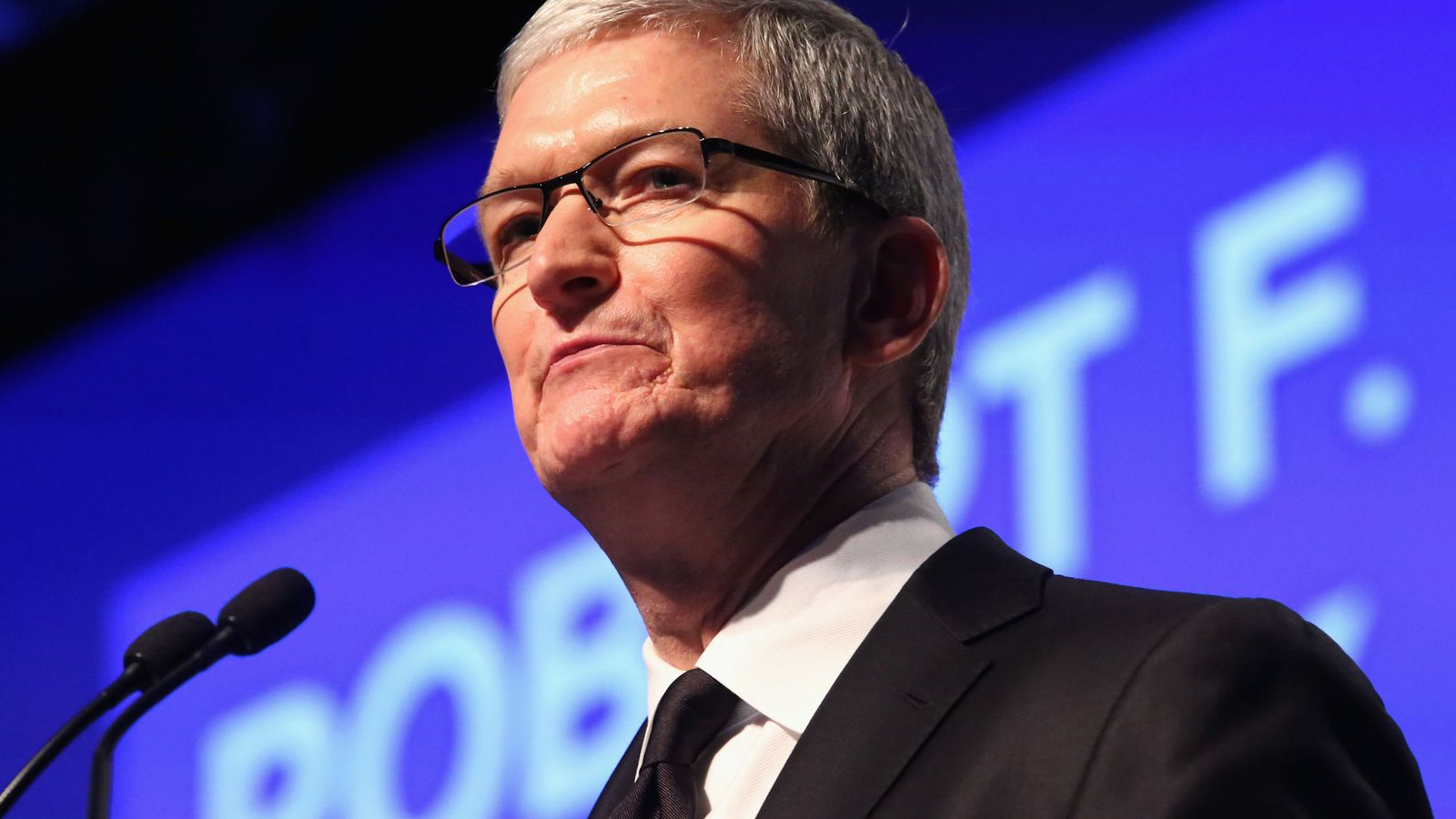 Apple cut Tim Cook's total pay 15 percent last year as it missed its sales and earnings goals