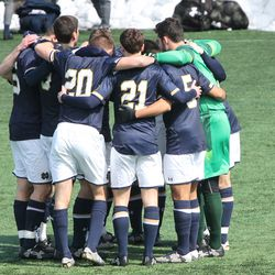 Notre Dame starters huddle before the start of the game