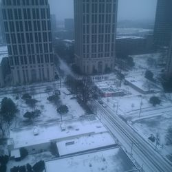 The intersection of West Peachtree and 14th streets was largely deserted as a second snow-packed night descended on the city.