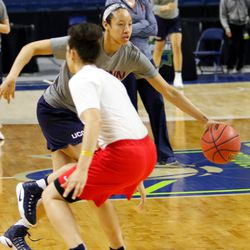 UConn's Saniya Chong dribbles past graduate assistant Chloe Pavlech during a drill during their Sweet 16 practice.<br>