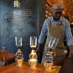 Brookland store manager Nicolas Gomis is enamored with siphon coffee service at Starbucks Reserve Bar.<br>