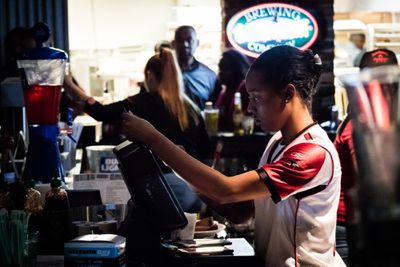 A Stats bartender pours a drink during the Super Bowl.