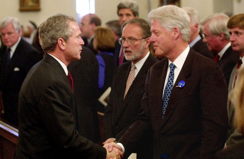 President George W Bush Shakes Hands With Former President Bill Clinton At The Funeral M