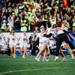 The Eagles mob goaltender Lauren Daly at the conclusion of the game