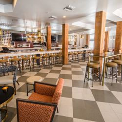 Guests from Tommy's Wine Bar will recognize the large cypress columns that remain at NOSH