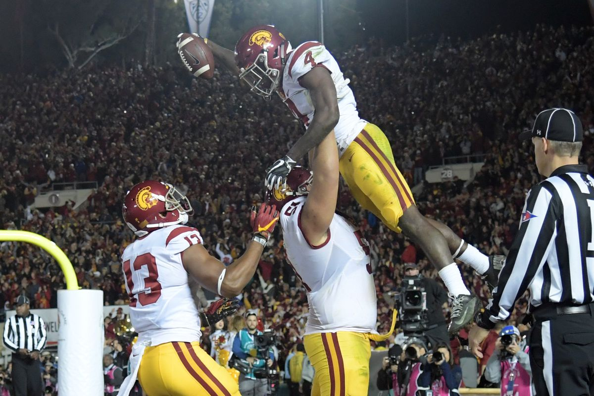 USC RB Ronald Jones punches the ball into the end zone