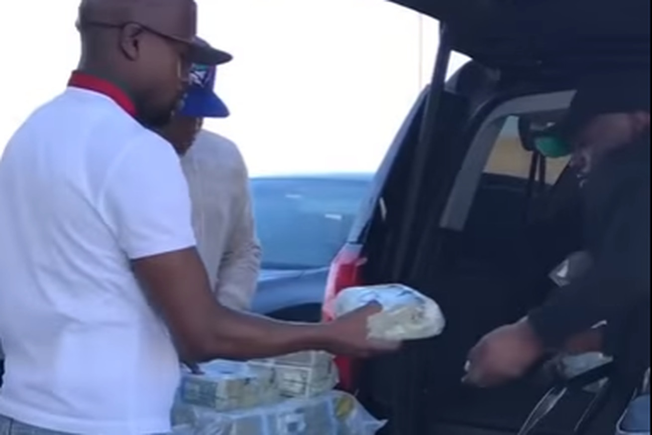 Video: Watch Floyd Mayweather load bags of money into SUV for strip club grand opening