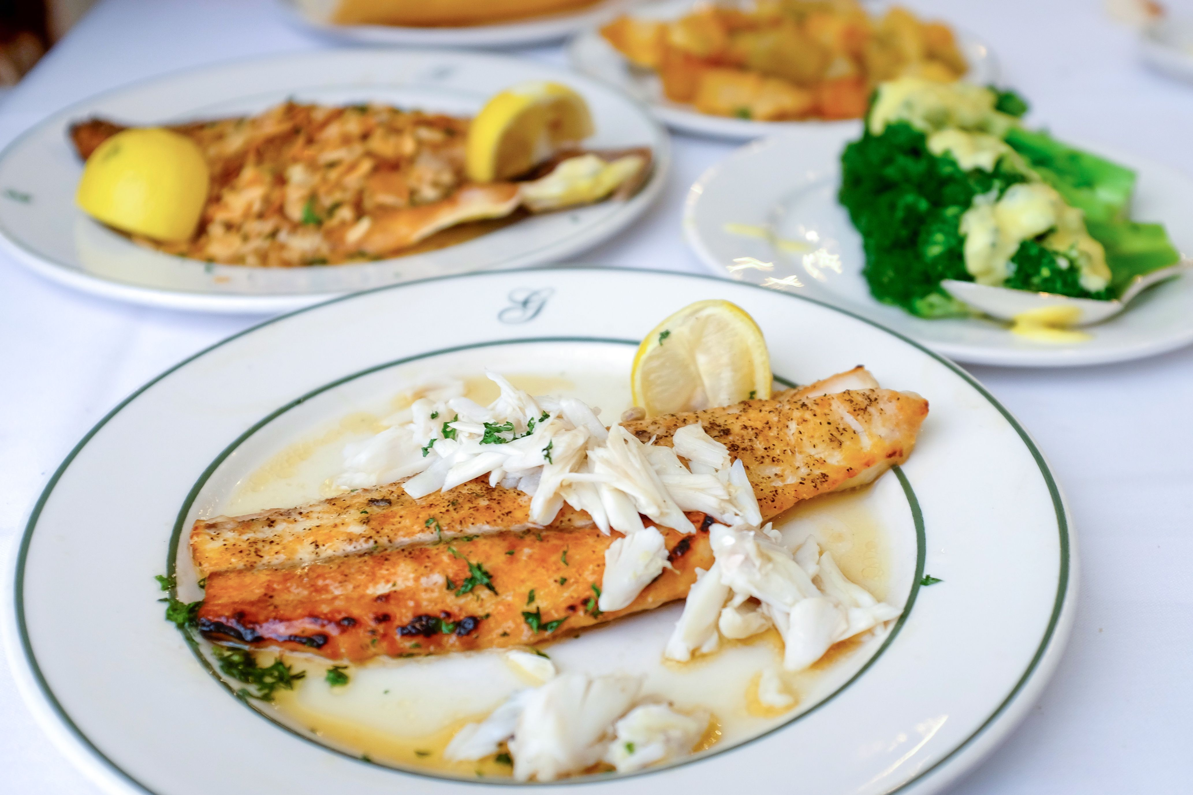 ... maison and shrimp remoulade); Right: Pompano meuniere with crabmeat