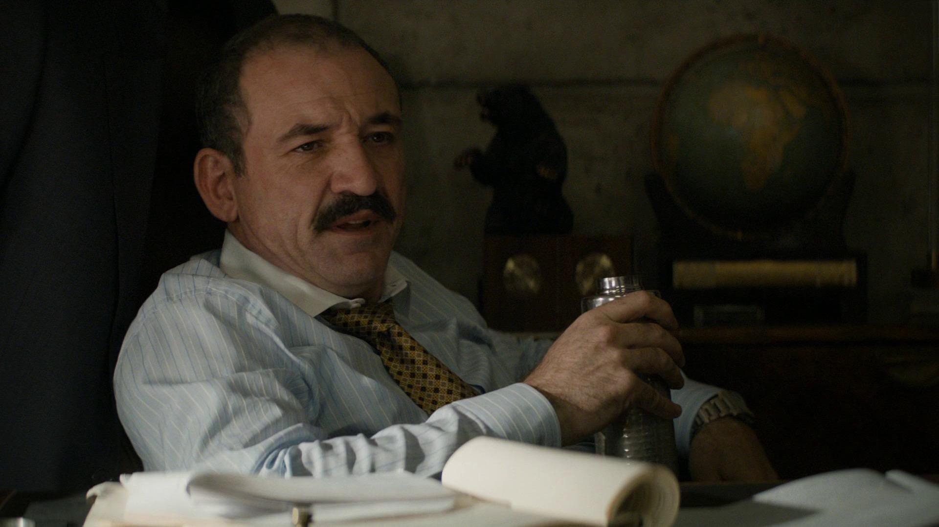 Mayor Chessani drinking at his desk
