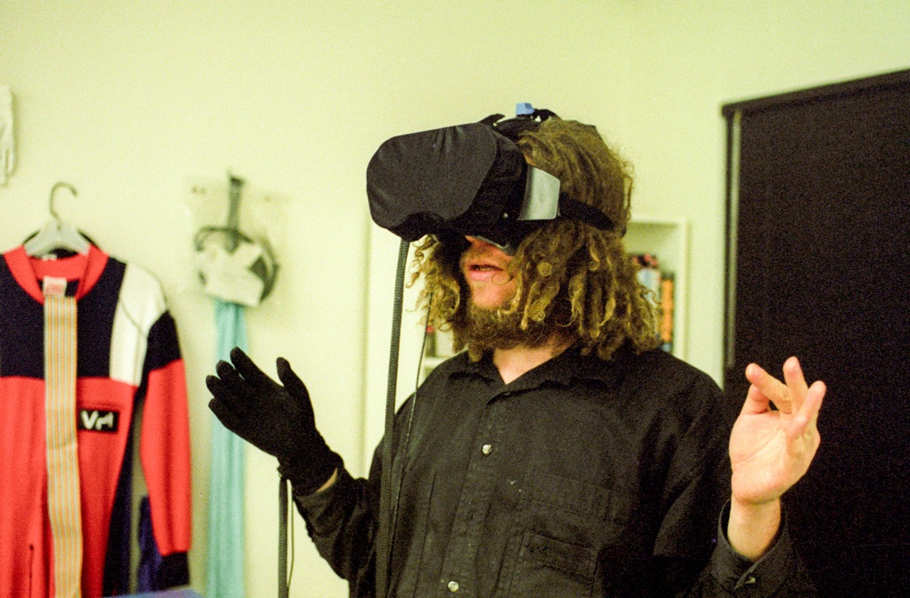 VPL co-founder Jaron Lanier in a DataGlove and head-mounted display