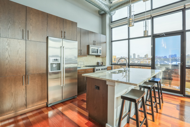 Lakeview corner unit with large wall of windows seeks $700K