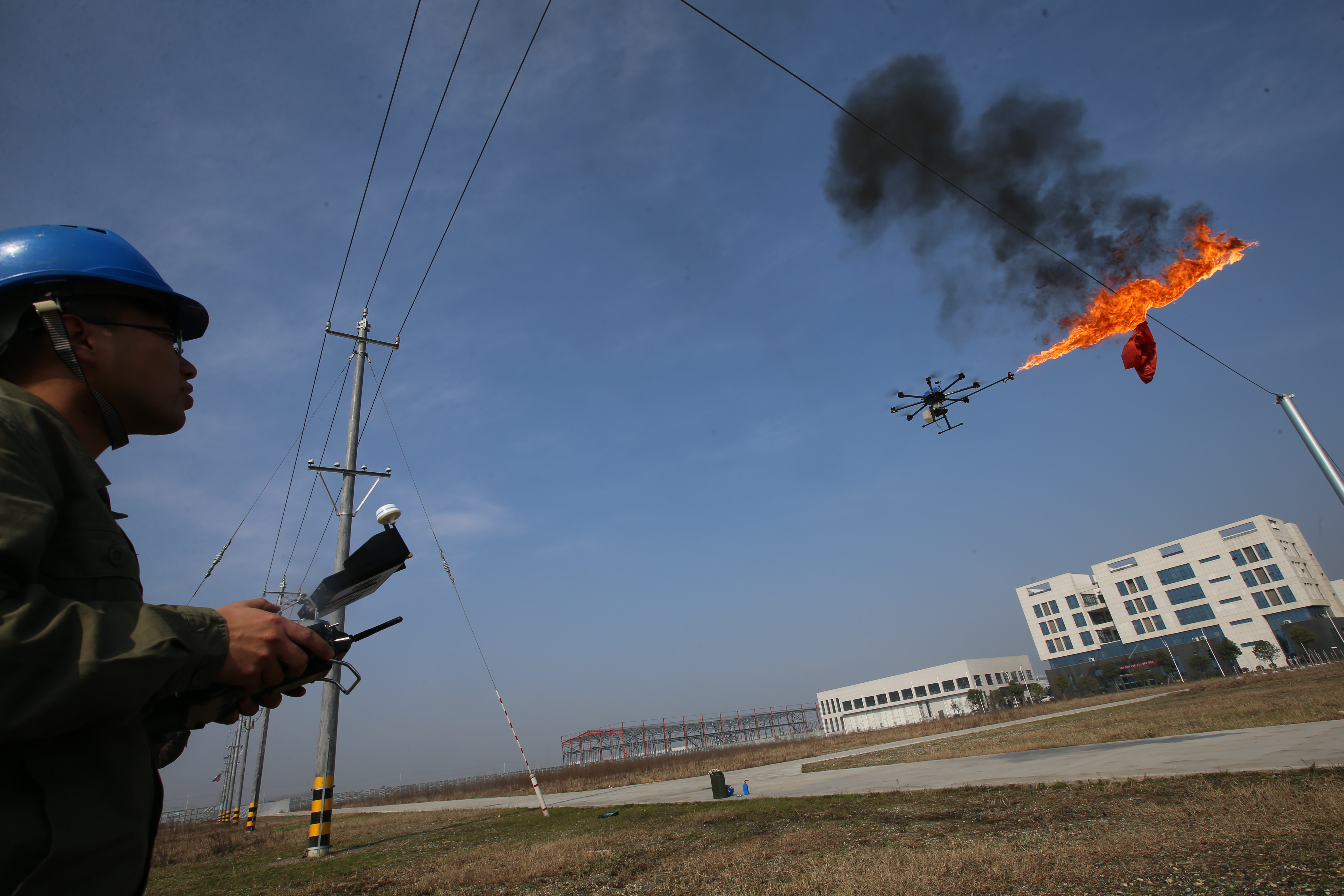 Fire-spewing drones are one way to get trash off your power line