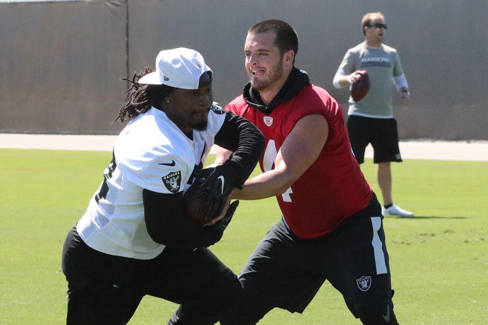Marshawn Lynch takes a handoff from Derek Carr in Raiders offseason  workouts Oakland Raiders a753e5df7